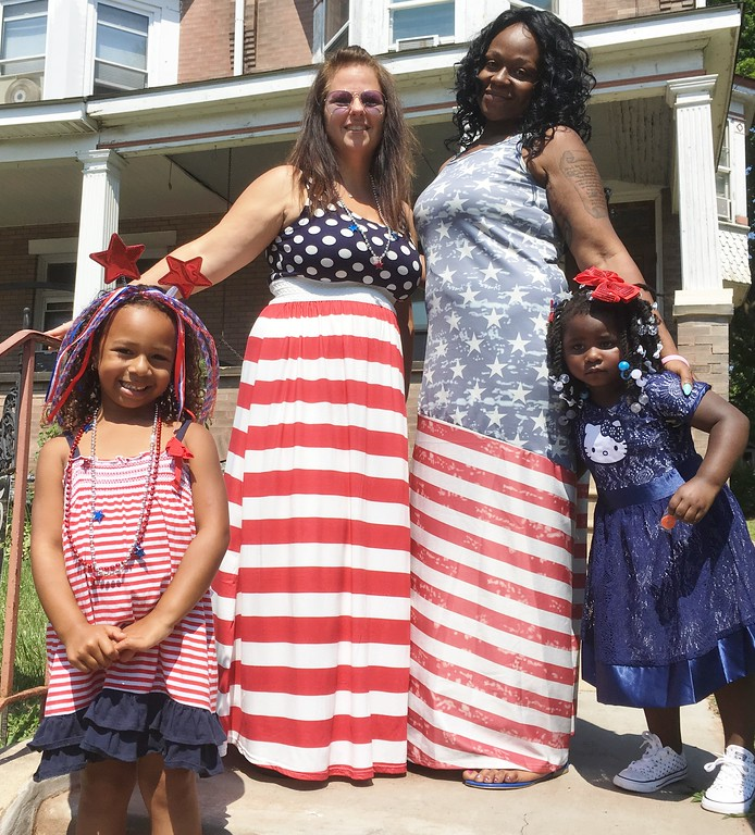 . Wearing their most patriotic dresses, Stanbridge Street neighbors Kathleen Beatty, left, and Julia Mayes pose for a photos after the Norristown Fourth of July parade has passed through their neighborhood Tuesday, July 4, 2017. With them are their daughters, Bella Beatty, left, and Stori Mayes. Joe Barron -- Digital First Media