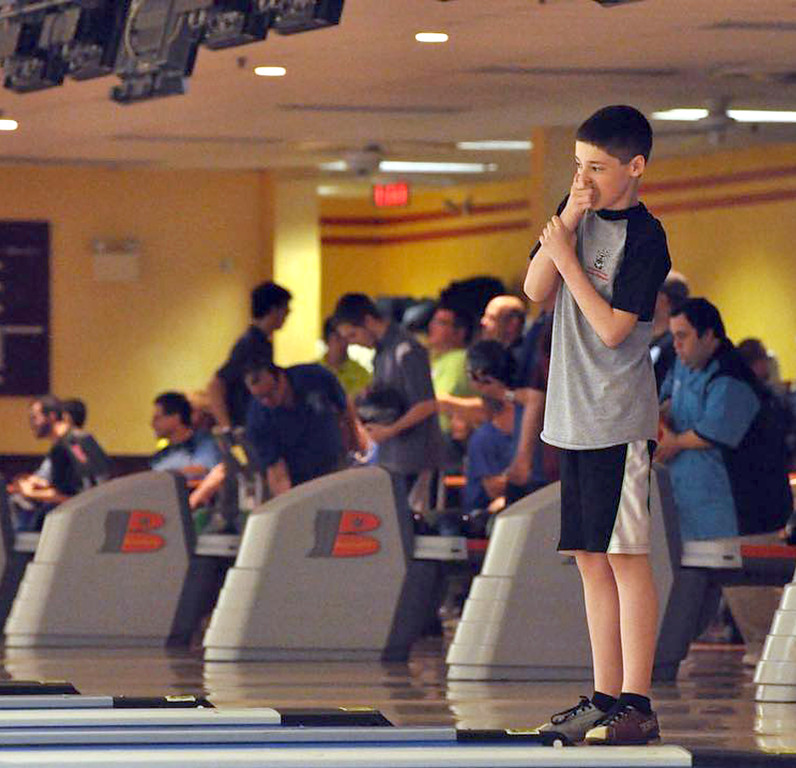 . Photo courtesy of Diane Hildebrand Jason Fuhrmeister from Montgomery County watchesas his ball strikes the pins during competition at the Summer Games.