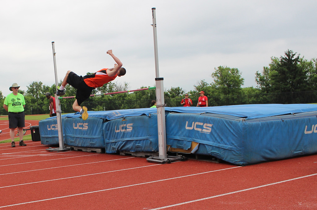 . Photo courtesy of Scott Otterbein Sean DeWees complets in the high jump at the Penn State games.