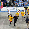 Photo courtesy of Brian Wingerter<br /> The torch is carried in during the opening ceremonies.