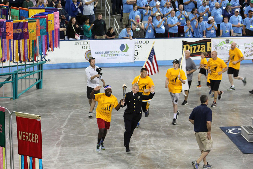 . Photo courtesy of Brian Wingerter The torch is carried in during the opening ceremonies.