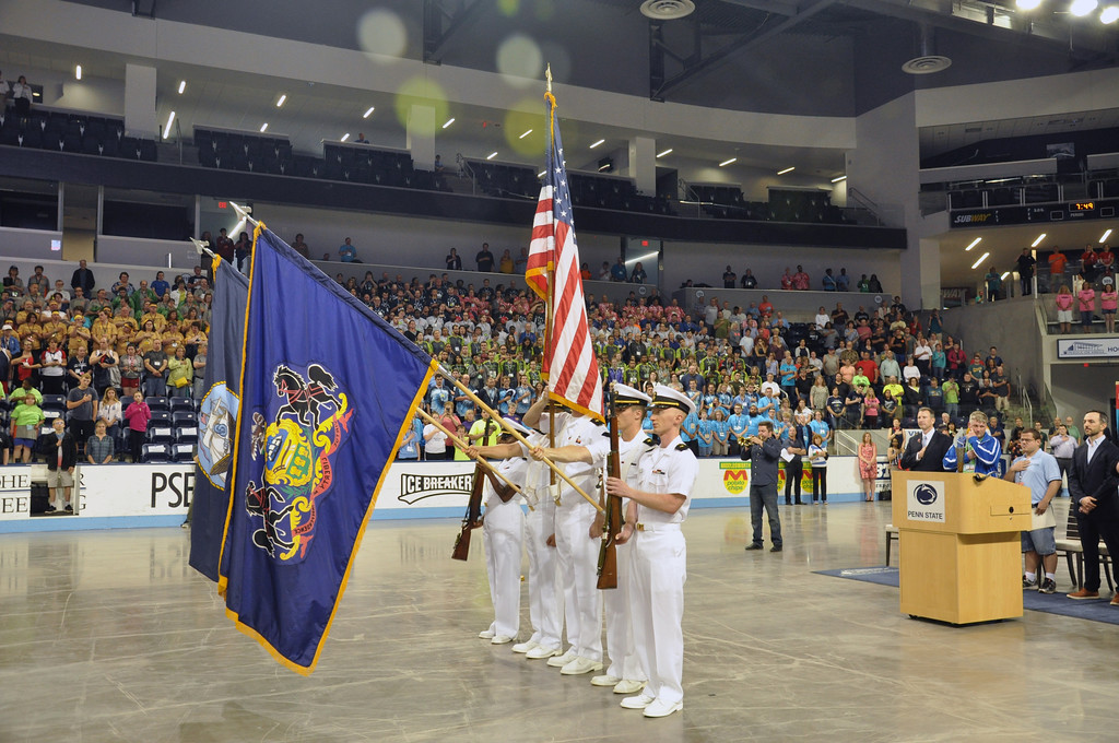 . Photo courtesy of SOPA The color guard stands at attention during the national anthem for the  opening ceremonies.
