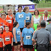 Photo courtesy of Brian Wingerter<br /> The Wicked Fast relay team of Lauren Otterbein, Richard Poosikian, Madison Wingerter and Cole Gemmill wait for their medals.