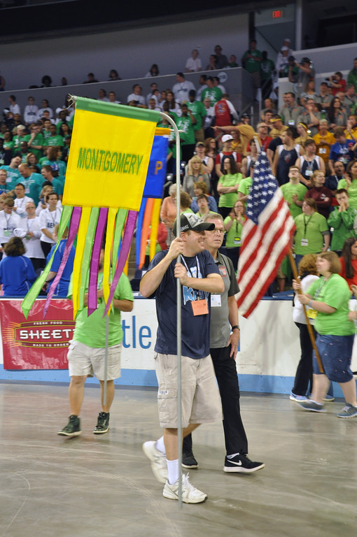 . Photo courtesy of SOPA Athletes and coaches carry in the Montgomery County flag during opening ceremonies. Head volleyball and basketball coach Fran Brett is seen on the right,
