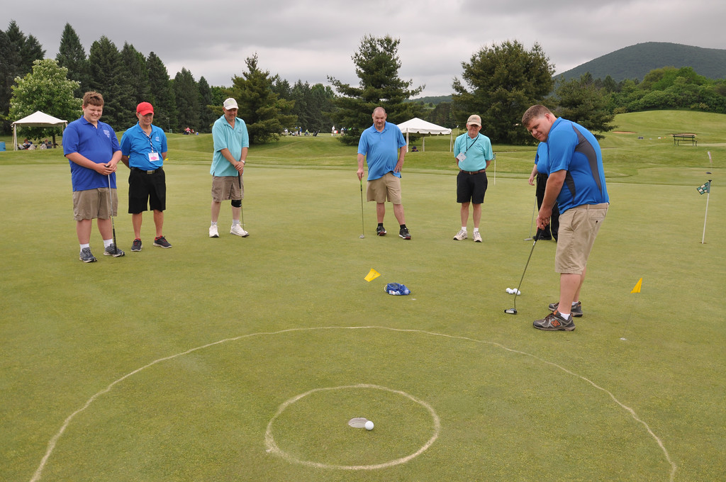 . Photo courtesy of SOPA Gerard Hasson sinks a putt as members of the Montgomery County golf team compete at the Summer Games at Penn State