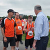 Photo courtesy of SOPA<br /> Wicked Fast coach Scott Otterbein, left, and athletes Tom Gibson and David Miller are greeted by U.S. Senator Bob Casey during the Summer Games at Penn State.