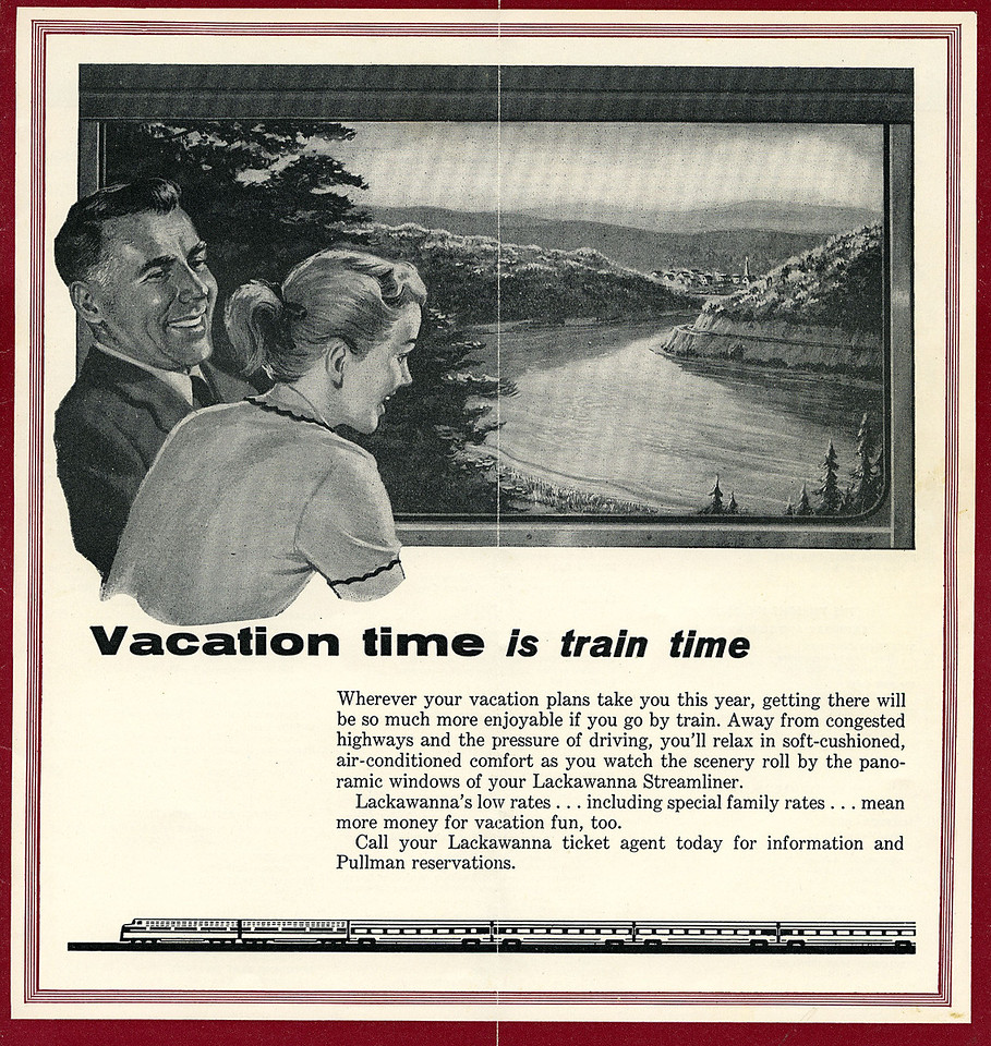 A middle aged dad and his daughter , at least that's what I think they are, enjoying travelling through the Delaware Water Gap on board a Lackawanna streamliner.