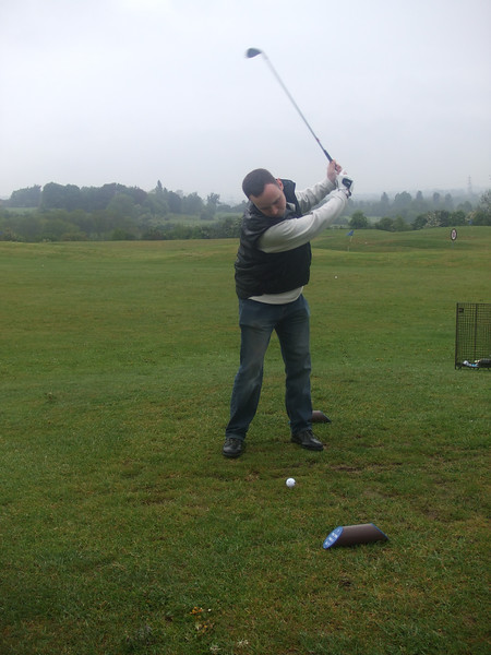Golf whatever the weather. Hangover-free didn't do much for Tim's game!