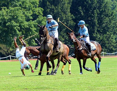 Victoria Halliday, center, races for the ball as Val Washington, left, is bucked off her horse.