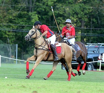 Al Gillen, left, leads the charge in a recent polo matchup at the Tinicum Polo Club in Upper Black Eddy. (John Gleeson – 21st-Century Media)