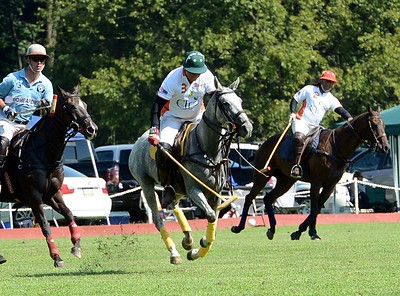 Hesham El-Gharby, manager of the Tinicum Polo Club, advances the ball.
