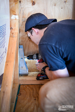 Gabe installing the HDU5 Holddowns  Read more here: http://tinyhousegiantjourney.com/2013/11/20/strapping-sheathing-framing-bbbbq-9/ Follow us here: www.facebook.com/tinyhousegiantjourney