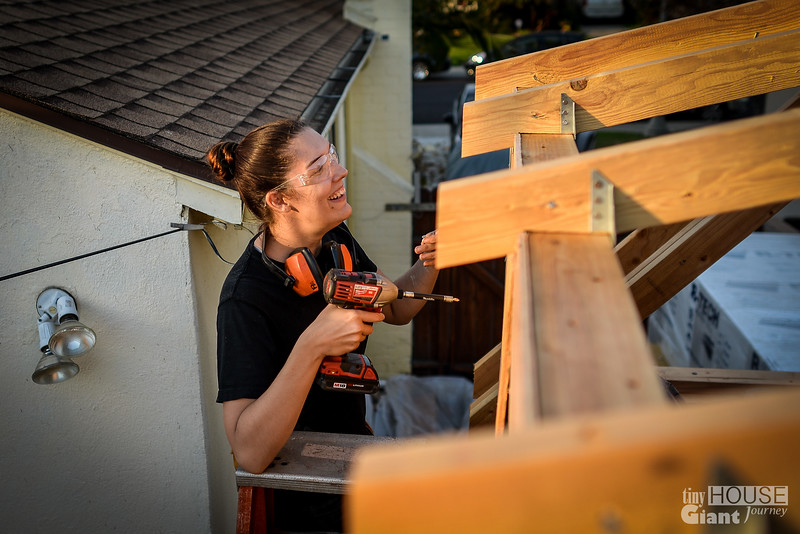 Dawn still working on the sheathing  Read more here: http://tinyhousegiantjourney.com/2013/11/20/strapping-sheathing-framing-bbbbq-9/ Follow us here: www.facebook.com/tinyhousegiantjourney