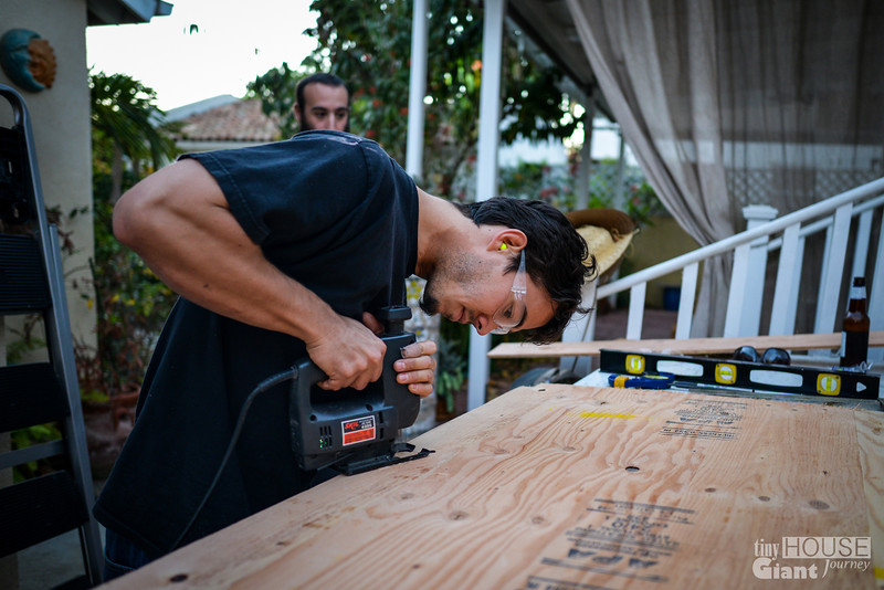 Cutting the openings for the rafters  Read more here: http://tinyhousegiantjourney.com/2013/11/15/strapping-the-roof-bbbbq-8/ Follow us here: www.facebook.com/tinyhousegiantjourney