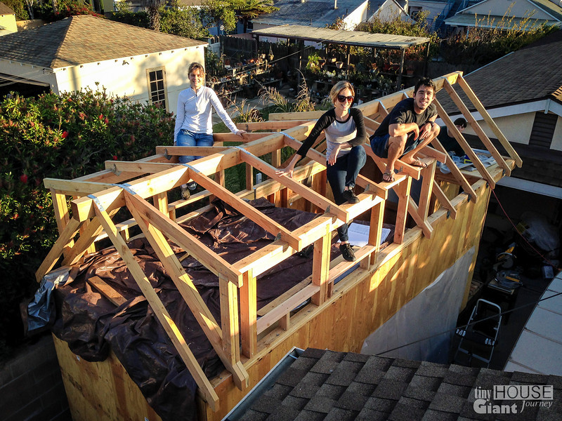 The strapping team  Read more here: http://tinyhousegiantjourney.com/2013/11/15/strapping-the-roof-bbbbq-8/ Follow us here: www.facebook.com/tinyhousegiantjourney