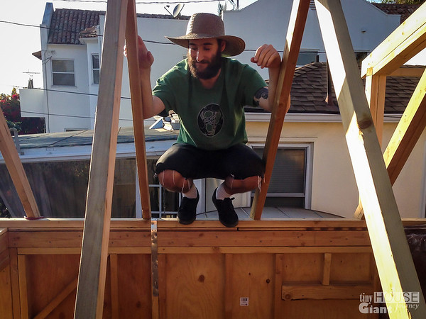 Justin posing  Read more here: http://tinyhousegiantjourney.com/2013/11/15/strapping-the-roof-bbbbq-8/ Follow us here: www.facebook.com/tinyhousegiantjourney