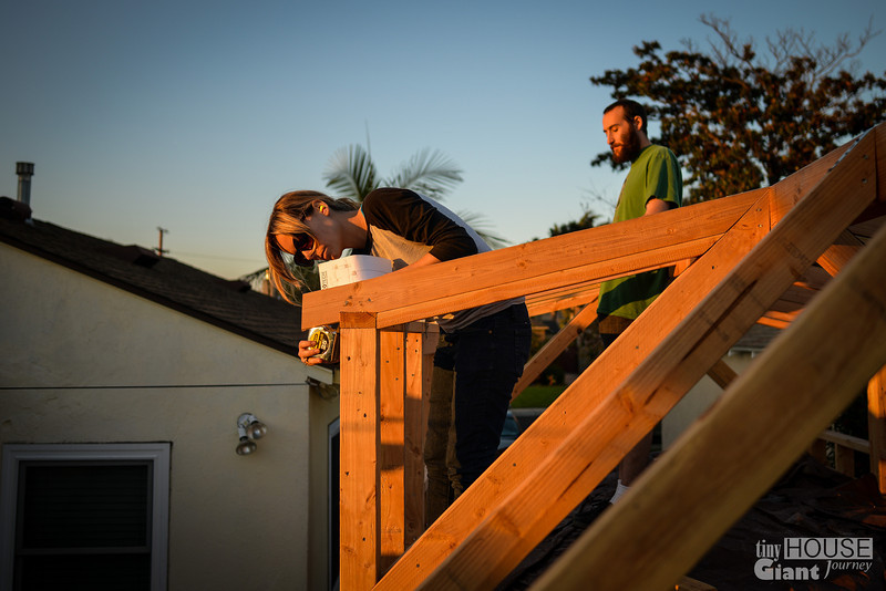 Measuring in the sunset  Read more here: http://tinyhousegiantjourney.com/2013/11/15/strapping-the-roof-bbbbq-8/ Follow us here: www.facebook.com/tinyhousegiantjourney