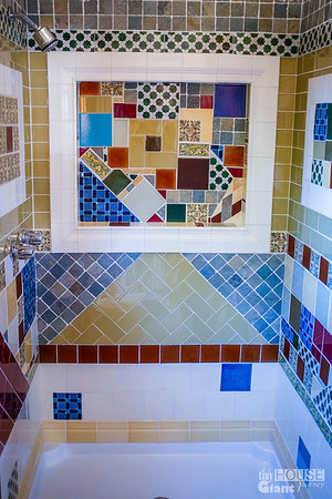 The Sugar Box tiled shower.  Read more here: http://tinyhousegiantjourney.com/2013/10/28/ojai-green-home-tour/ Follow us here: www.facebook.com/tinyhousegiantjourney