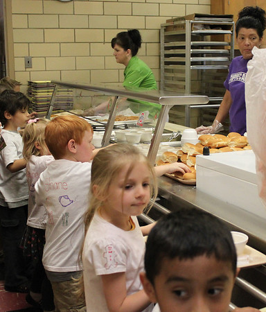 Kindergarteners eat lunch at Nevin Coppock