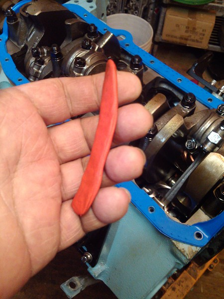 With very clean hands or non-powdered gloves, form a piece of modeling clay into a strip of about 1/2 inch by about 3 inches, clean the underside of the suspect connecting rod with acetone to get as much oil as possible off the connecting rod. The clay will not stick if the rod is oily.