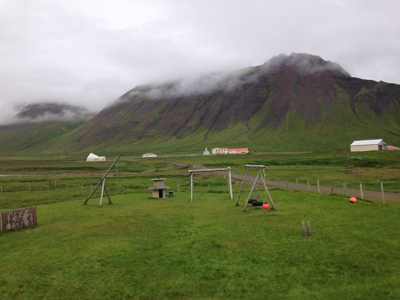 Horft frá Finnbogastaðaskóla. Gamla kirkjan sést fyrir miðri mynd, byggingin lengst til vinstri er minjasafn.