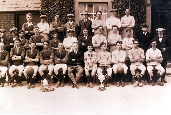 Hodson Rovers league winners 1921-2 with Vic the dog,two teams
