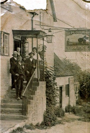 Landlord and his wife of the Plough with customers 1905