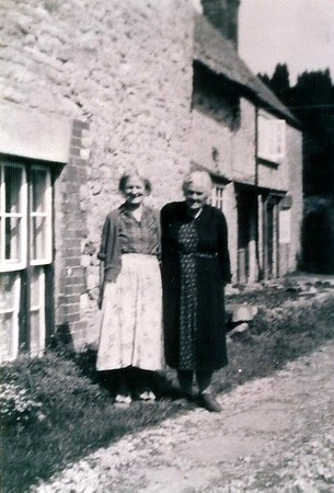 Jessie Coward and Mrs Hutchins outside Draycot Cottages 1950