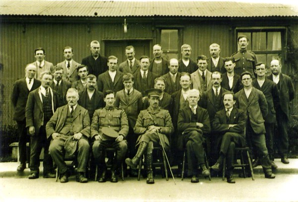 The CO pictured with civilian staff 1920`s