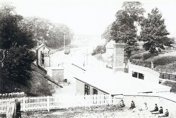 Station Approach with school children waiting at side of bridge 1881