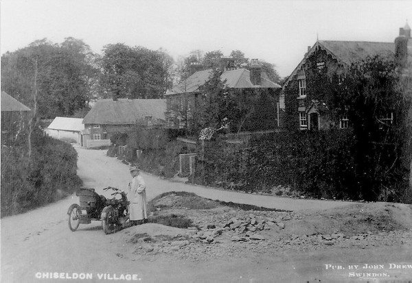 Mrs William Hooper,wife of the photographer who travelled Wiltshire`s villages on his motorcycle and side car..Infants school to the right.