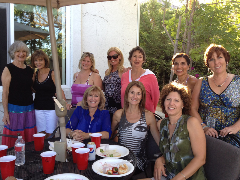 This is my fun tennis team (minus 4 who couldn't come) shown at our end-of-season celebration.  I was overcome with shock when they gave me a $250 Thank You gift!  Btw, Candi and I were the only two gals who went swimming with the kids--it was a family swim party.