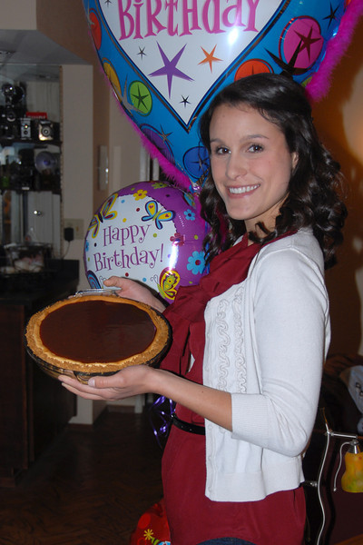 Molly on her 24th birthday. She made her own cake; caramel-covered cheesecake.