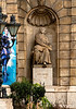 25 Apr 18	Back to the Budapest State Opera today and a look at a small corner of the main entrance. As I've written previously I was in awe of all the statuary we encountered wherever we went, and of course all the main buildings were adorned with multiple pieces of artwork.  Obviously the stature of Franz caught my eye, but what caught it even more was the tacky - a bit of personal bias in evidence - plastic banner announcing some individual's upcoming performance. The juxtaposition of color, material, design, and gender was just too much. I couldn't help but think that it might have been intentional. But intentional or not, it certainly was tacky! Your opinion my vary.  I was planning on discontinuing these trip photos once we left for Yellowstone, but after reviewing what I have yet to share they will continue for some time.<br /> <br /> As you all know I beta test for Topaz and try to keep those of you interested in their products up to date. Today the company released an announcement that they were putting ALL of their products on sale at 40% off through 07 May. For those of you who have looked at the free Topaz Studio editor, the Propack adjustment set with this sale would get you ALL 24 of the additional adjustments (plug-ins) for ($166.50) roughly 25% of the individual products.<br /> <br /> I took the base image, removed a couple very small distractions, and gave it a small amount of contrast enhancement.  Nikon D500; 18 - 200; Aperture Priority;  ISO 2000; 1/400 sec @ f / 9.