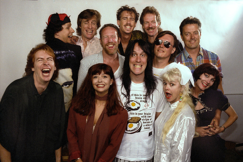 Todd Rundgren and his band posing backstage at the Palace of Fine Arts in San Francisco on July 7, 1990.