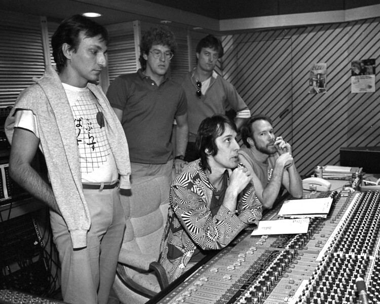 "Todd Rundgren & members of The Tubes listen to playbacks during the recording of ""Love Bomb"" in 1985. (L-R): Rick Anderson, Roger Steen, Prairie Prince, Todd Rundgren, Vince Welnick."