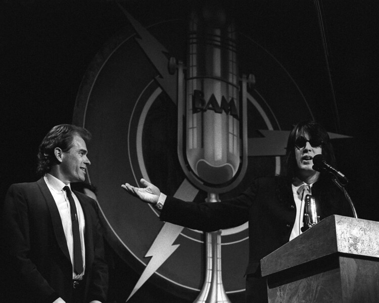Todd Rundgren, after receiving the Bammie for Best Keyboard Player in 1990, turns over the award to his keyboardist, Byron Alred.