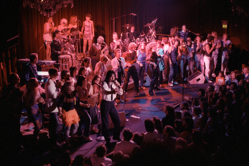SAN FRANCISCO, CA-July 12: Todd Rundgren and his band performing with members of the audience at the Fillmore Auditorium in San Francisco on July 12, 1989. (Photo by Clayton Call/Redferns)