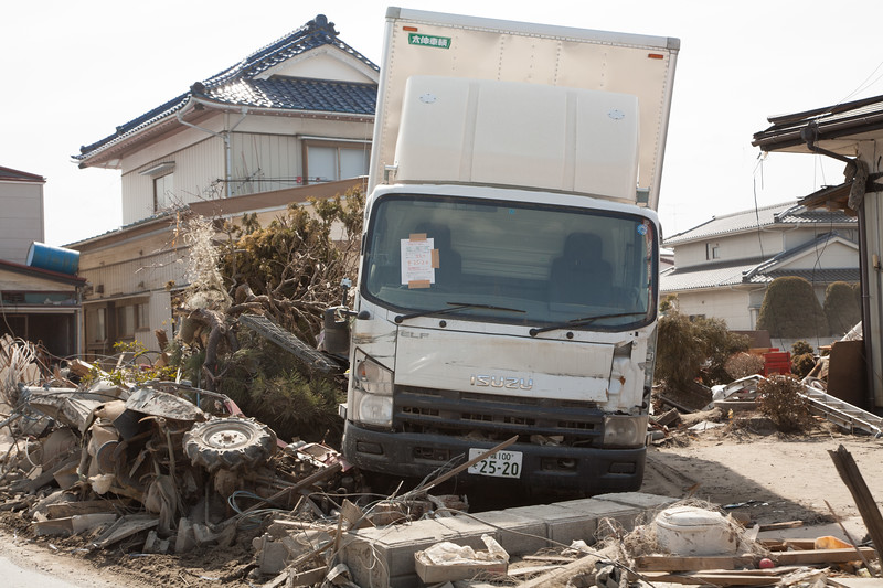 Even just a few weeks only after the tsunami the wreckage is carefully marked. Here a truck with model and number plate registered on a form stuck to the windscreen.