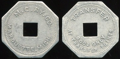 TRANSPORTATION -- Michigan Lot 118:  M.C. RY. CO. / (c/o sq) / MARQUETTE, MICH. // Transfer / (c/o) / Good Only / At Transfer Points., al oc 25mm.  MI 605Ka $75 -- SOLD $89