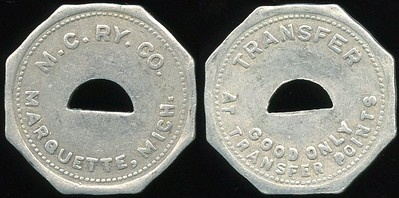 TRANSPORTATION -- Michigan Lot 121:  M.C. RY. CO. / (c/o crescent) / MARQUETTE, MICH. // Transfer / (c/o) / Good Only / At Transfer Points., al oc 25mm.  MI 605Pb $75 -- SOLD $89