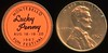 STICKER COIN - California<br /> Lot 471: MONTEBELLO / LUCKY / PENNY / AUG. 18-19-20 / 1967 / FUN FESTIVAL, (CA), orange/black label rd 17mm imprint on 1967 Lincoln cent.  Unlisted!    G5-(EV$8/16)-MB$ - DNS