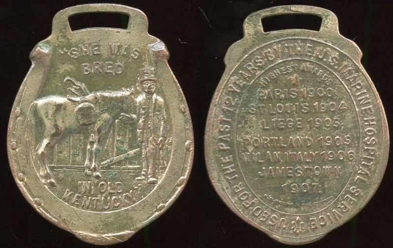 "MISCELLANEOUS - Fob, Green River Whiskey<br /> Lot 494:  (slot) / ""SHE WAS / BRED / (man holding mule packing jug inscribed incuse: GREEN RIVER) / IN OLD / KENTUCKY"" // Used For The Past 12 Years By The U.S. Marine Hospital Service / Highest Awards / Paris 1900 / St Louis 1904 / Liege 1905 / Portland 1905 / Milan Italy 1906 / Jamestown / 1907 / (sm: S.D. Childs & Co. Chicago), br solid horseshoe 33x43mm, brown patina, mild porosity, wm-plating traces.  G3-(EV$25/50)-MB$20"
