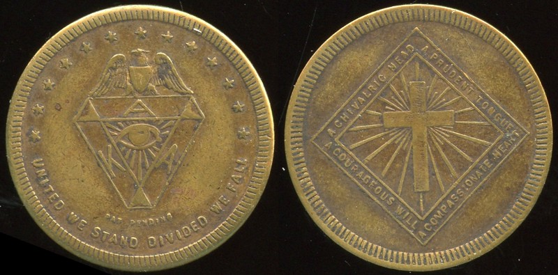 KU KLUX KLAN<br /> Lot 476:  (eagle) / (shield: A / K (eye) A / (sm: PAT PENDING) / UNITED WE STAND DIVIDED WE FALL // A Chivalric Head / A Prudent Mind / (cross) / A Courageous Will / A Compassionate Heart, br rd 31mm.  Listed KK-211.  G3-(EV$25/50)-MB$20 - SOLD $39