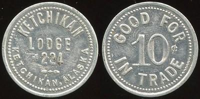 ALASKA - Ketchikan<br /> Lot 55:  KETCHIKAN / LODGE / #224 / KETCHIKAN, ALASKA // Good For / 10¢ / In Trade, al rd 23mm. Unlisted value 25 – 5¢ value @$300.   G3-EV$175/350-MB$100