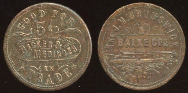SOUTH DAKOTA - Mitchell, DT<br /> Lot 439:  GOOD FOR / 5¢ / BECKER & / MEDINGER / IN / TRADE // The / J.M. Brunswick / & / Balke Cos / (billiard table), (Mitchell, DT), br rd 25mm.  Unlisted – listing provided to OLTDB.   G3-EV$35/70-MB$20 // SOLD $160