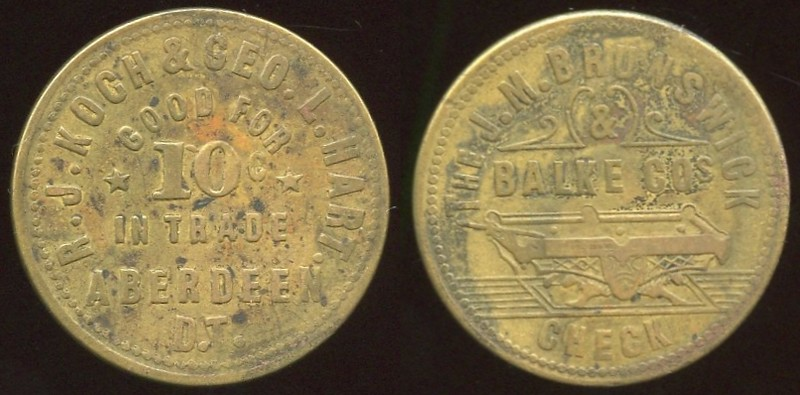 SOUTH DAKOTA - DT, Aberdeen<br /> Lot 433:  R.J. KOCH & GEO. L. HART. / GOOD FOR / 10¢ / IN TRADE / ABERDEEN / D.T. // The J.M. Brunswick Balke Cos / (billiard table) / Check, br rd 24mm.  Unlisted!    G4-EV$1,250/2,500-MB$1,000