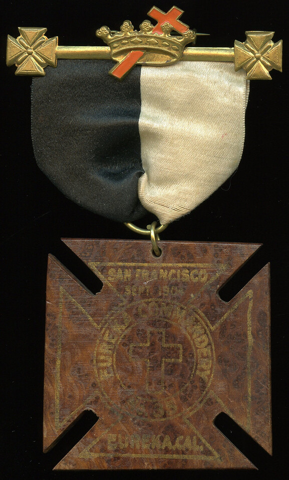 SAN FRANCISCO -- Knights Templar  Lot  381  Hanger:  KT emblem // (pin); ribbon: black/white; badge: SAN FRANCISCO / SEPT. 1904 / EUREKA COMMANDERY / (cross) / 1835 / EUREKA, CAL. // (uniface), gilt imprint on wood, Maltese cross 63mm; overall 77x129mm.  Highly unusual!     G4-($16-$32) Sold as part of group lot 405 $555.00