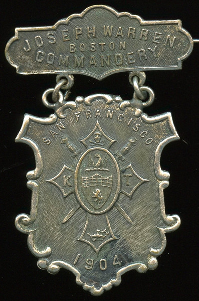 SAN FRANCISCO -- Knights Templar<br /> <br /> Lot 393  Hanger: JOSEPH WARREN / BOSTON COMMANDARY // (pin) / (incuse: Boston Regalia Co.); badge: SAN FRANCISCO / (ornate KT emblem) / 1904 // (uniface), (MA), wm 31x39mm; overall 35x54mm.    G4-($16-$32)  Sold as part of group lot 405 $555.00