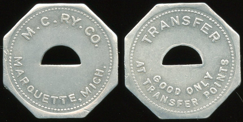 TRANSPORTATION -- Michigan<br /> <br /> Lot  153  M.C. RY. CO. / (c/o sm) / MARQUETTE, MICH. // Transfer / (c/o) / Good Only / At Transfer Points, al oc 25mm.  MI 605Pa $75    G4-MB $75 Sold $90.00